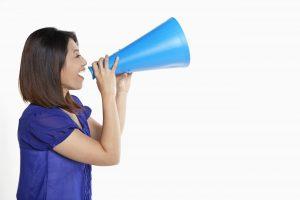 Woman shouting into a megaphone